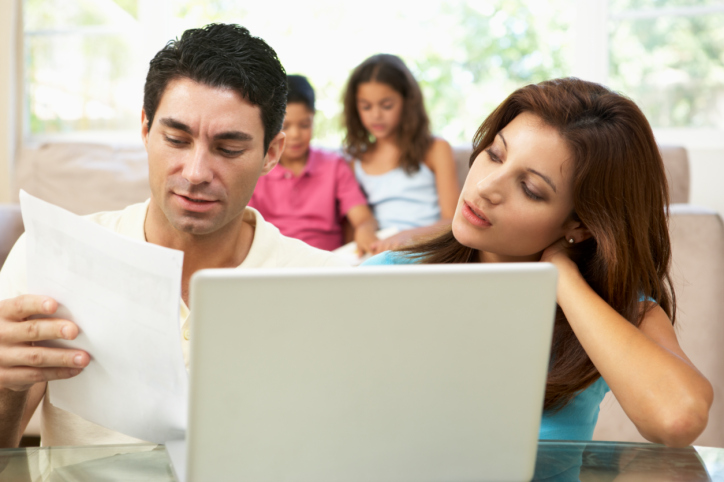 Parents Using Laptop At Home